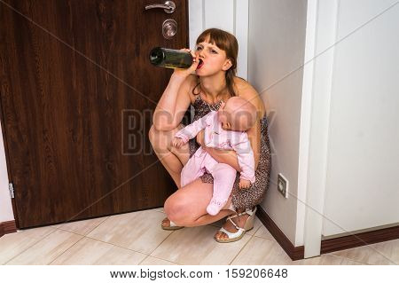 Drunk Reckless Woman Drinking Alcohol And Holding Her Baby