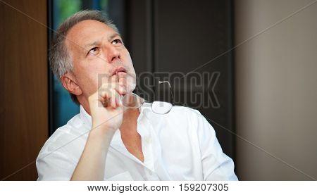 Portrait of a pensive senior businessman