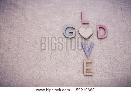 Love God wooden words toning copy space background