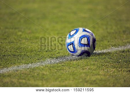 Soccer ball on Grass Pitch or field