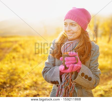 Young Smiling Woman With Mug In Hands Enjoying Fall Season