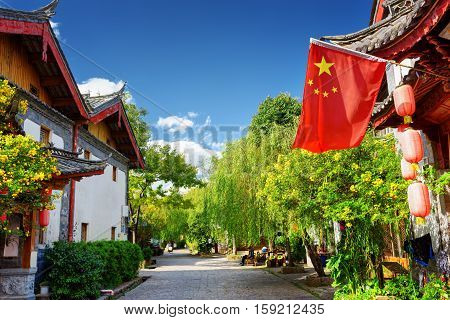 The Flag Of China In The Old Town Of Lijiang, China