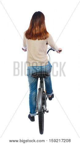 back view of a woman with a bicycle. cyclist sits on the bike. Rear view people collection.  backside view of person. Isolated over white background. Brunette on the bike slowly going forward.