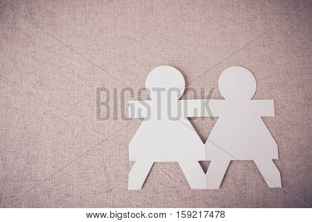paper dolls holding hands copy space background