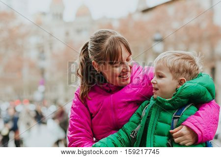 mother and little son travel in European city, family travel Europe