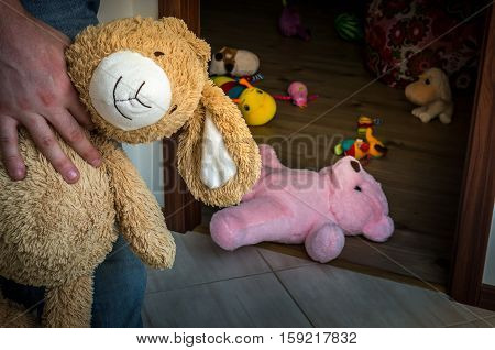 Picture Of Pedophile Standing In The Child Room With Cuddly Toy