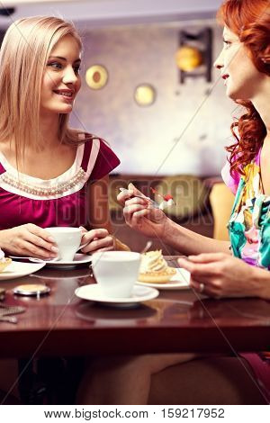 Two young women sitting at cafe table