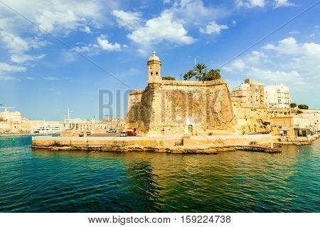 view of Valletta with watch tower and Gardjola Gardens in Senglea from the sea, Malta