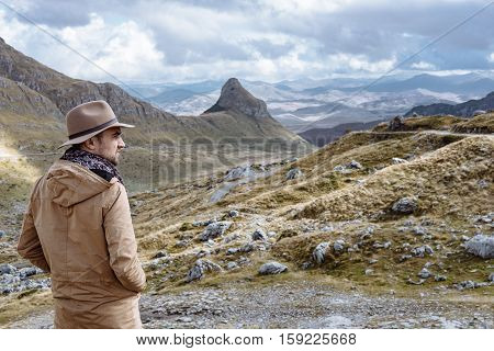 Young Man In Hat Starting An Adventure In The Mountain In Montenegro