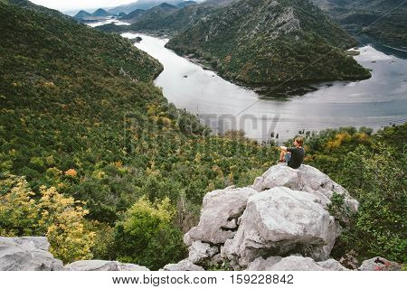 Man Traveler Sitting On The Mountain And Gaping, Freedom Concept
