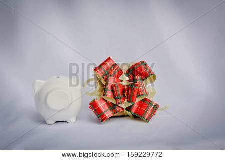 Little beautiful piggy bank and gift box on white background vintage tone and soft focus concept of chritmas and new year day