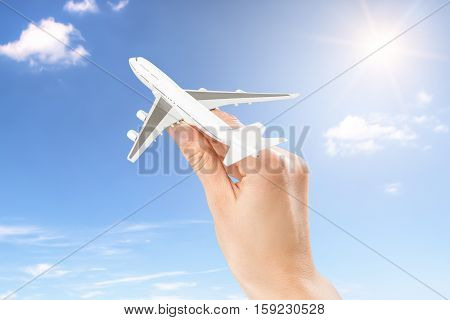travel inspiration trip flight plane fun photo cloud dream business hand taking fly airport off airplane holiday concept - stock image