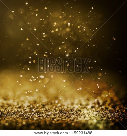 glitter glittering background light shimmering gold golden shine spark shimmer yellow pattern dust bright glitz concept - stock image