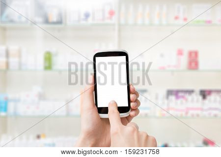 screen phone pharmacy smart hand blank mobile background white store medical business medicine shelf pharmacist blurred concept - stock image