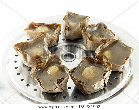 "close-up group of Chinese pastry (Chinese language called ""nian gao"") on aluminum steamer tray, kind of Chinese traditional sweetmeat steamed in basket. Often make and given in major Chinese festivals poster"