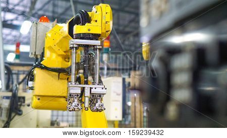 industrial machine and factory robot concept - Blurred of factory robot arm with control box and copy space. Use for robot factory artwork concept