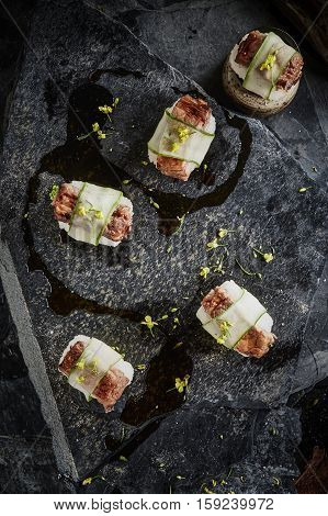 Spare Ribs (Sushi) with sauce on dark background.