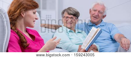 Couple Listening To Reading Woman
