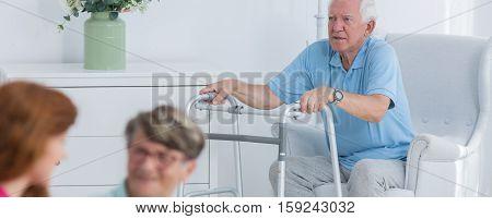 Senior With The Walking Frame