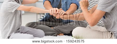 Man Holding His Sons Hands