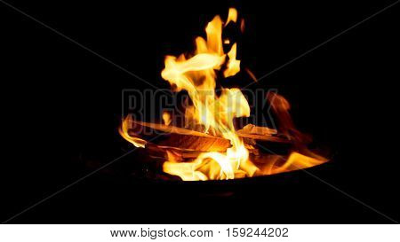 Warm orange bonfire with pieces of wood