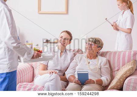 Senior Lady And Nurse In Luxury Clinic