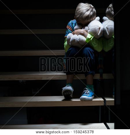 Vertical view of scared boy at night