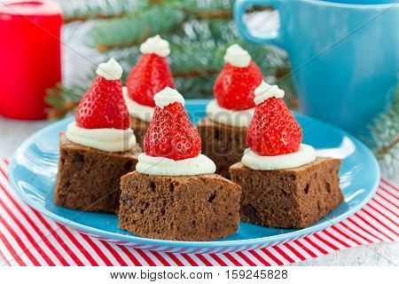 Christmas Santa hat brownies dessert idea cake brownie with cream and strawberry Christmas and New Year holiday dessert food