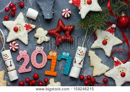 Happy New Year 2017 composition - holiday concept with gingerbread cookies Christmas decoration and sweets Christmas and New year food background