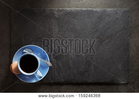 cup of coffee and slate background