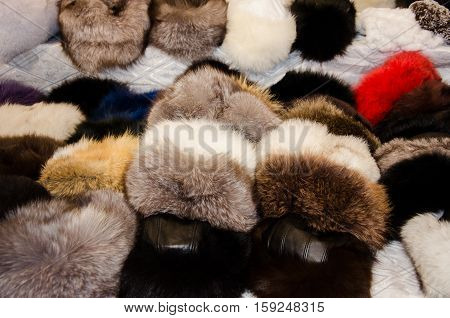 Group of dozen furry Russian traditional winter hats