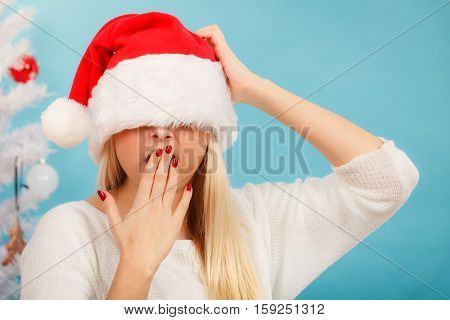 Sleepy Woman In Santa Claus Hat