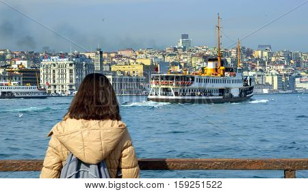 Istanbul Turkey - March 29 2013: Istanbul Ferries watching a woman. Istanbul Ferries (called vapur in Turkish) continue to serve as a key public transport link for many Thousands of commuters tourists and vehicles per day.