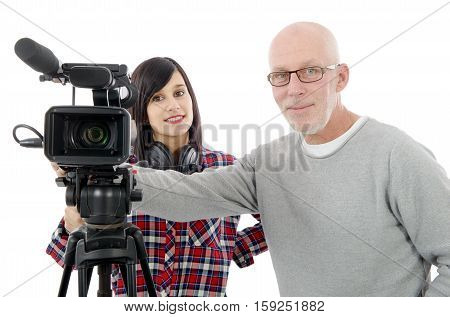 young brunette woman cameraman and the mature man