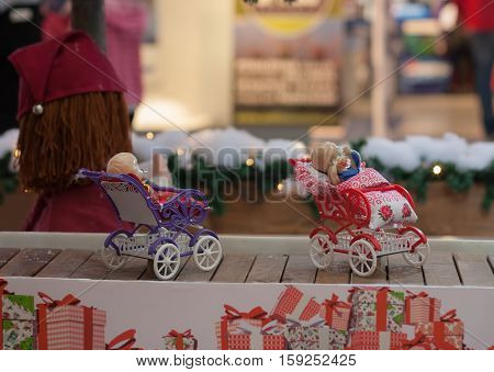 BRNO,CZECH REPUBLIC-NOVEMBER 19,2016:Miniature doll buggies on conveyor belt at shopping center Olympia on November 19, 2016 Brno Czech Republic