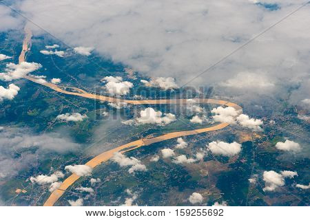 land and cloud view from Airplane Window Seat Travel Background