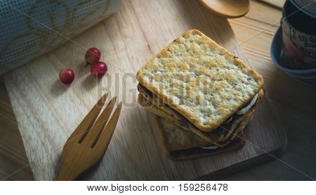 Smores placed on wooden table against ray of light