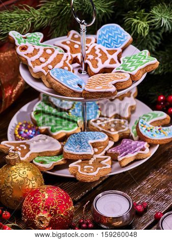 Christmas gingerbread cookies on Tiered Cookie Stand. Christmas tree background.