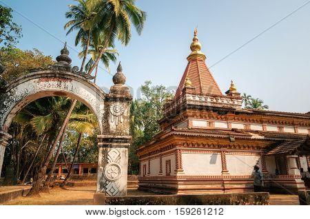 Morjim Goa India - December 08 2014: Ancient Hindu Shree Morjai Temple at Morjim amidst a coconut grove. In the temple celebrate Kalas Utsav. The walls are adorned with the rare and extinct Kaavi art friezes