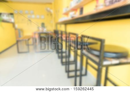 Abstract background of empty indoor bar wooden stool standing next to bar table