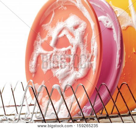 Plates With Cleaning Foam In Dishwasher
