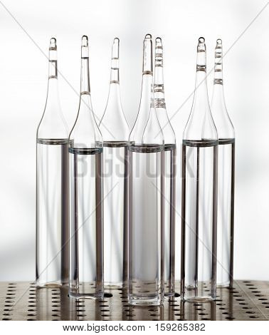Several Ampoules On Light Background