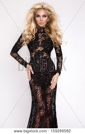 Beautiful Tall Slim Blonde With Amazing Body Dressed In An Elegant Dress Lace Dress Stands On White