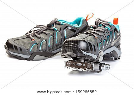Pair of cycling boots with pedal attached to the sole isolated on white background.
