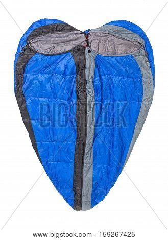 Two sleeping bags buttoned in the shape of a heart isolated on white background.