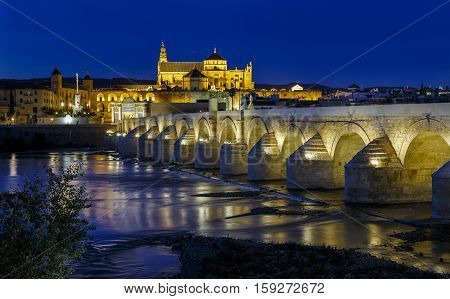 old roman bridge and tower Calahora at night Cordoba Andalusia Spain
