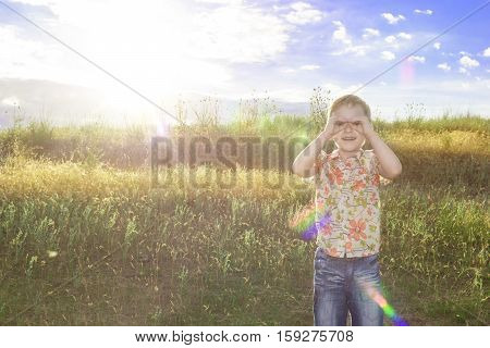 Active Kid Spending Happy Time On Summer Meadow By Sunset