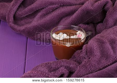 Hot Cocoa or chocolate cozy knitted blanket. Winter still life.