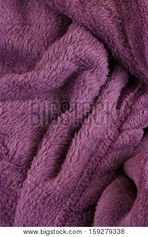Dark purple bath fluffy towel or blanket