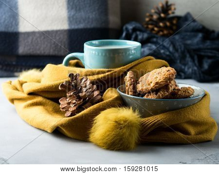 Mug Of Tea With And Cookies In Winter Scarf